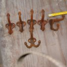5 Matching Cast Iron Double Hooks And One Tripple