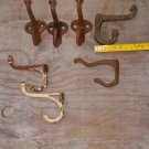 Group Of 4 Matching Cast Iron Hooks