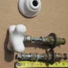 Two faucet stems with porcelain knob