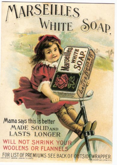 Reprint of vintage Marseilles white soap ad little girl on bike