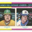 1975 Topps baseball card #311 (C) ERA Leaders Jim Catfish Hunter & Buzz Capra NM