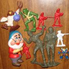 Odd assortment of toy figures - army soldiers, owls, frog warrior, disney Dwarf, more