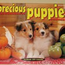1997 Precious Puppies calendar - 8.5x11 Huskies Beagles Samoyeds Dobies, Shelties, more!