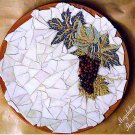 ZEUXIS GRAPES. A DECORATIVE PLATE