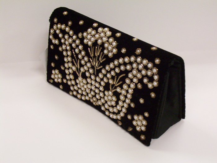 Black purse with bean floral