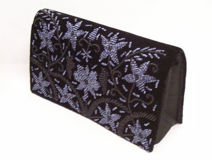 Black purse with purple flowers pattern