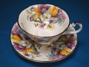 Fine bone china England footed tea coffee cup saucer purple yellow blue flowers Crown mark porcelain