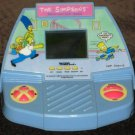 Simpsons Electronic LCD Handheld Games Cupcake Crisis Acclaim Homer Bart 1989 1990 Tiger Electronics