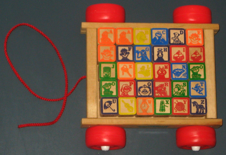 Sold Sesame Street Abc Alphabet Wooden Blocks Wagon Tootsie Toy Big