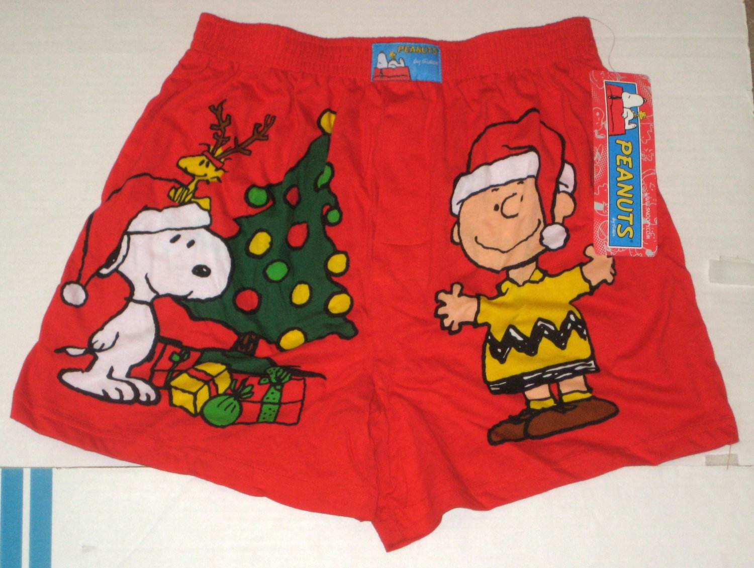 These red satin boxer shorts have a soft silky feel and feature Snoopy dancing along the front with