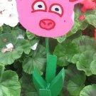 Pink pig  garden flower wood