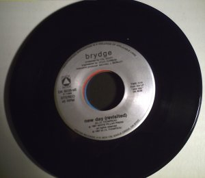 Brydge   New day (revisited)/single copy.........1987