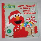 Sesame Street Have Yourself a Furry Little Christmas Board Book by Naomi Kleinberg