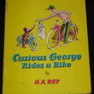 Curious George Rides a Bike by H. A. Rey 1952 Scholastic Paperback Book