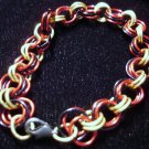 Red, Black and gold chain maille bracelet