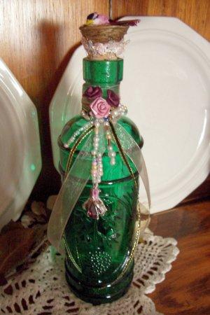 Altered, Jeweled Bottle with Tiny Bird on Nest