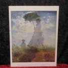 "Monet Print, ""Woman with a parasol"" Dated 1995"
