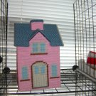 Pink plastic canvas house