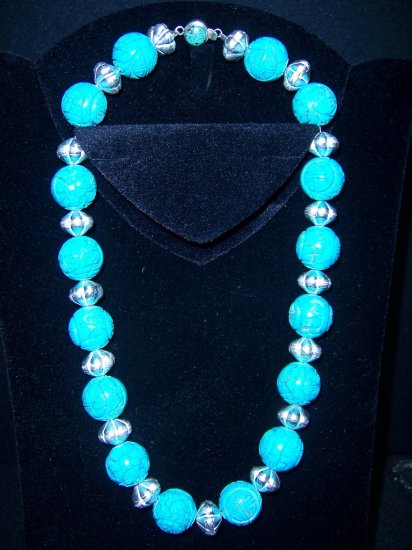 Carved Tibetan Turquoise with matching bracelet