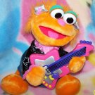 Rock & Roll Zoe, Sings, Plays Guitar, toys,