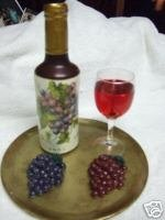 Wax wine bottle and grapes