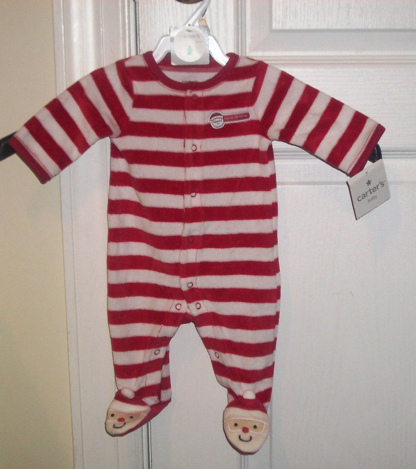 "Your baby can join in on the fun festivities of the holiday with this cute set. It's made of pure cotton so baby stays cozy and boasts the words ""My First Christmas"" on the behind."