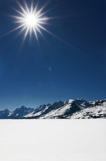 Sunburst Over a Frozen Jackson Lake