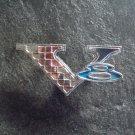 V 8 emblem ornament