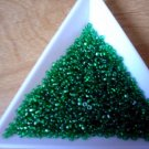 Size 11 Matsuno seed beads transparent emerald 15 grams