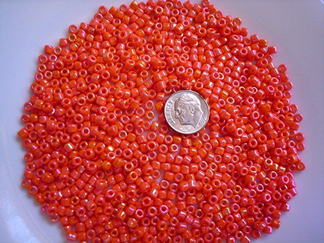 Size 6 seed beads Opaque Rainbow luster 25 grams Orange