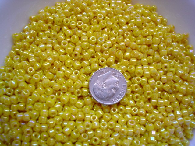 Size 6 seed beads Opaque Rainbow luster 25 grams Yellow