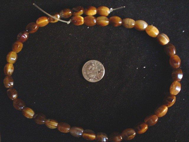Tigereye gemstone stone beads Six sided oval 12X8 mm 15 inch strand