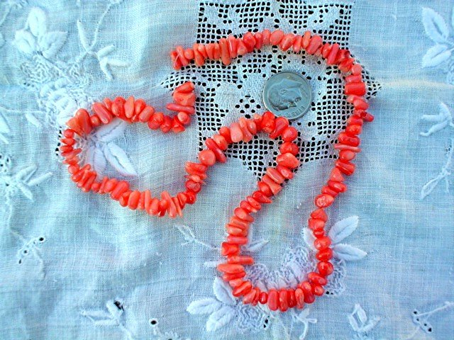 Pink coral cuppolini beads 16 inch strand.