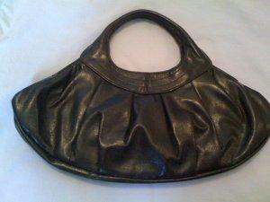 Black patent leather handbag.
