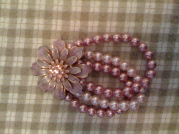 Faux pearl bracelet.