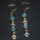 Turquoise glass beads, crystal clear Swarovski crystals and gold plated round bead earrings