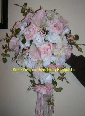 pink rose and white rose with calla lily wedding bouquet