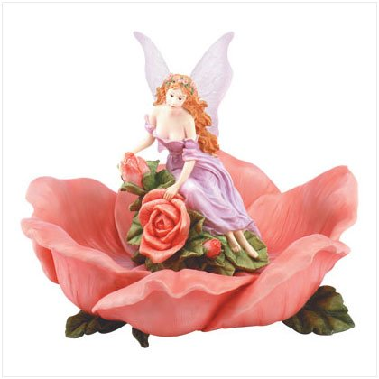 Fairy on a rose bird feeder