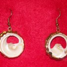 Fashion Costume Jewelry, a pair of   tortise shell earrings trimmed in gold.