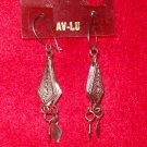 Fashion, Costume Jewelry, a pair of Silver diamond shaped pierced earrings, w/ cut design in center