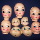 3 inch assorted doll heads, soft plastic