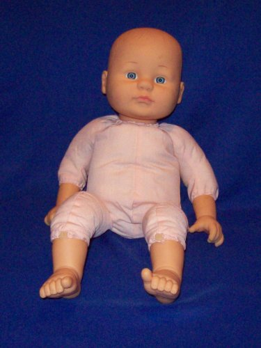 Baby boy doll, vinyl head, soft cloth body with flexible arms and legs.