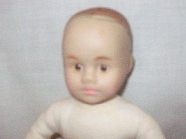 Baby boy doll, decorator,porcelain head, arms cloth body with flexible arms and legs.