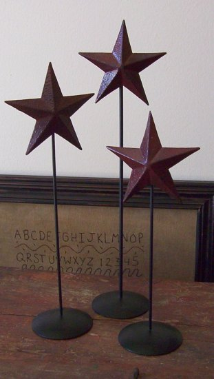 Primitive barn red Tin Stars