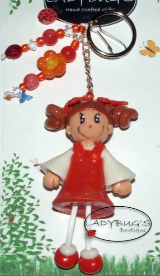 OOAK Handcrafted zipper pull Girl with curly hair and orange dress