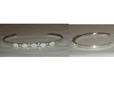 Cute sterling silver bracelet adorned with pretty opal