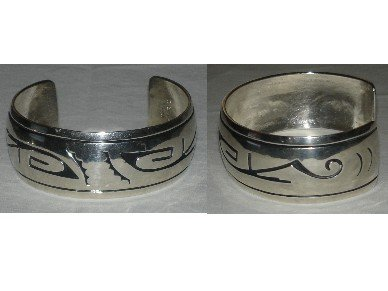 Sterling silver bracelet adorned with amazing OVERLAY navajo designs