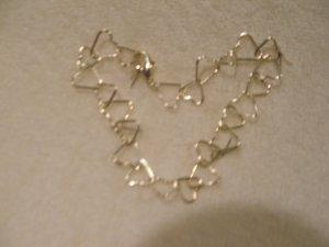 Silver toned Hearts Bracelet