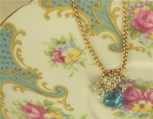 A M E L I E - -- Faceted Swiss Blue Topaz Briolette With Labdorite, on a Gold Oval Rolo Chain