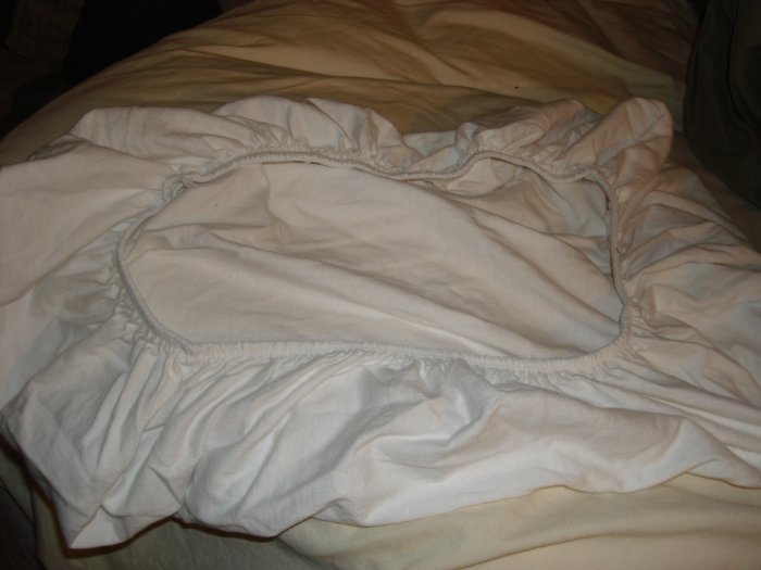 White fitted bassinet sheet